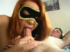 Masked milf polishes cock