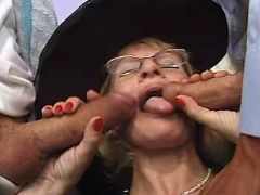 Granny throats two cocks in group