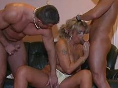 Lustful granny sucks cocks by turns
