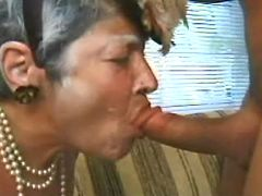 Lewd granny sucking cock