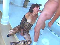 Dirty mature whore in fishnet throating meaty dick