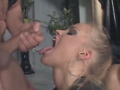 Latex whore fucks and gets cumload