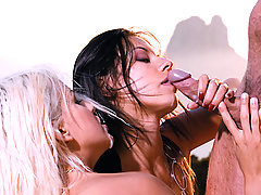 A blonde and a brunette getting dirty outdoor