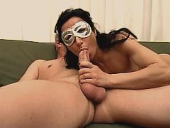 Masked mature sucks cock and fucks