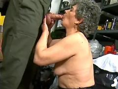 Grandma greedily sucking fat cock
